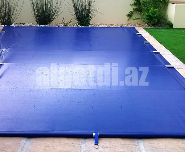 The-PowerPlastics-Solid-Safety-Cover-Blue-PowerPlastics-Pool-Covers-8-600×492-1