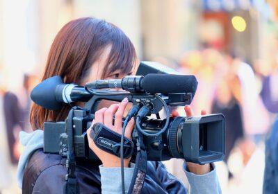 female cameraman shooting video recording